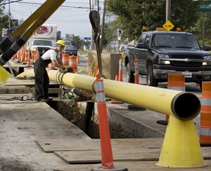 Workers lay a natural gas pipeline in Dartmouth, N.S. on Wednesday, Oct. 3, 2007. The National Energy Board says it has strengthened regulations for oil and natural gas pipelines to make them safer. THE CANADIAN PRESS/Andrew Vaughan