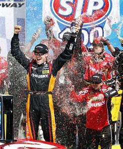 Matt Kenseth (20) celebrates in Victory Lane after winning the NASCAR Sprint Cup Series auto race at Kansas Speedway in Kansas City, Kan., Sunday, April 21, 2013. (AP Photo/Orlin Wagner)