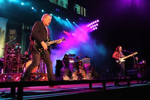 The power trio Rush performs on Nov. 1, 2012, in Atlanta. It's been a long week for Rush and a long time coming, their long-awaited induction into the Rock and Roll Hall of Fame and the unusual schedule it's created. THE CANADIAN PRESS/AP - Robb Cohen, Invision