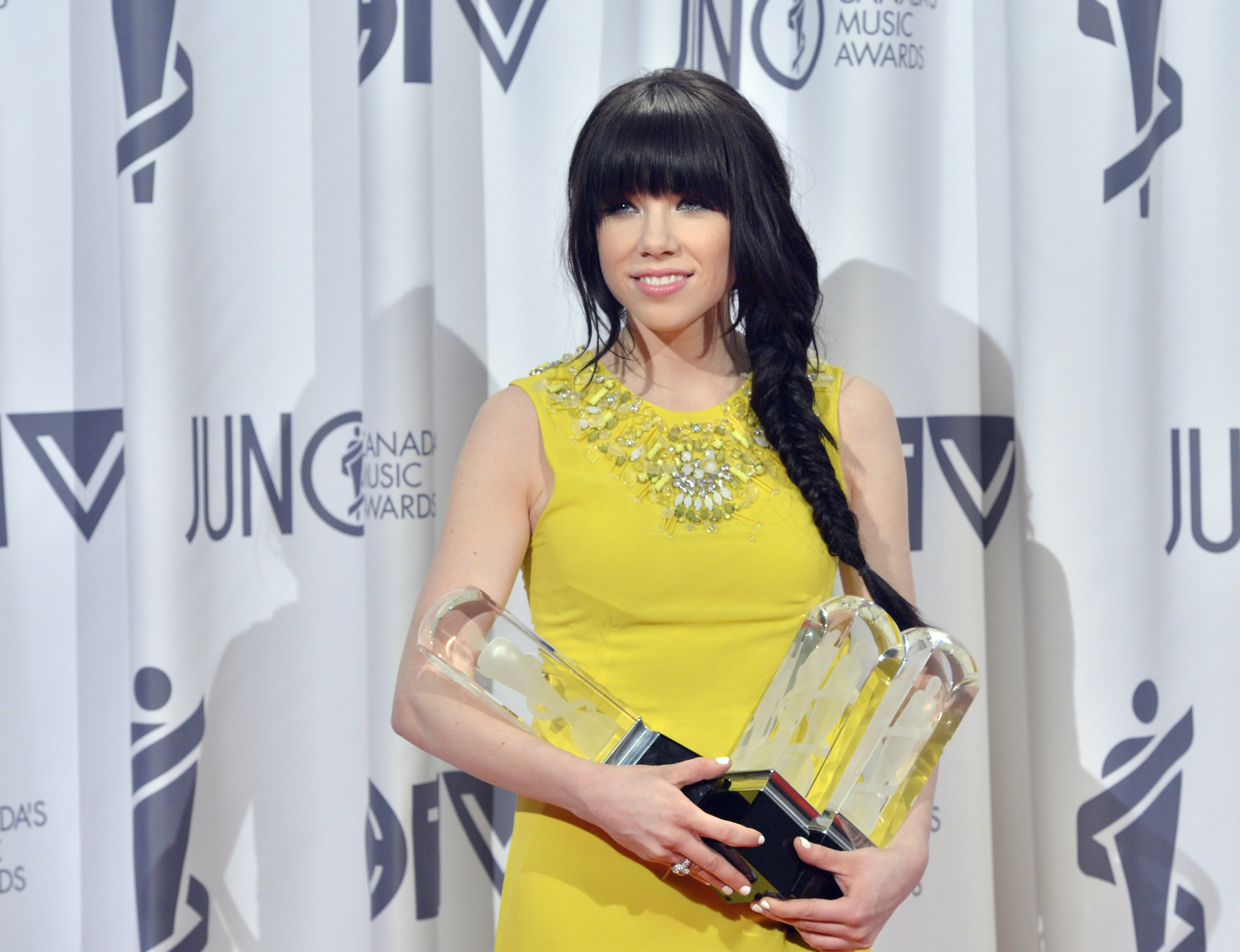 Carly Rae Jepsen poses with the Juno after winning pop album of the year, album of the year, and single of the year of the Year during the 2013 Juno Gala, Dinner and Awards in Regina on Sunday, April 21, 2013. (Yellow sapphire ring Jepsen is wearing by Jupiter Jewelry)