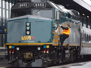 A Via Rail employee climbs aboard a locomotive at the train station in Ottawa on Monday, December 3, 2012. U.S. authorities say they have arrested a man in connection with an alleged plot to attack a Via Rail train that travels between the U.S. and Canada. The United States Attorney for the Southern District of New York says the man is a Tunisian national. He was arrested on April 22, after travelling to the U.S. from Canada.THE CANADIAN PRESS/Adrian Wyld