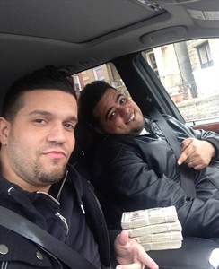 In this undated photo provided by the United States Attorney's Office for the Southern District of New York, Elvis Rafael Rodriguez, left, and Emir Yasser Yeje, pose with bundles of cash allegedly stolen using bogus magnetic swipe cards at cash machines throughout New York. Prosecutors in New York said on Thursday, May 9, 2103 said that they are members of worldwide gang of criminals who stole $45 million in hours by hacking into a database of prepaid debit cards and draining cash machines around the globe. An indictment unsealed Thursday accused U.S. cell ringleader Alberto Yusi Lajud-Pena and seven other New York suspects of withdrawing $2.8 million in cash from hacked accounts in less than a day. (AP Photos/U.S. Attorney's Office for the Southern District of New York)