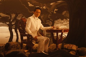 "This undated photo released by Forward Entertainment, shows Japanese actor and producer Jackie Woo on the set of ""Death March"" inside a studio in suburban Marikina, east of Manila, Philippines. Filipino director Borinaga Alix Jr. chose to film ""Death March"" in black-and-white and almost entirely inside a studio using hand-painted backdrops, with close-ups of actors' painted faces portraying their struggles with nightmares and hallucinations in one of the bloodiest episodes of World War II. (AP Photo/Forward Entertainment)"