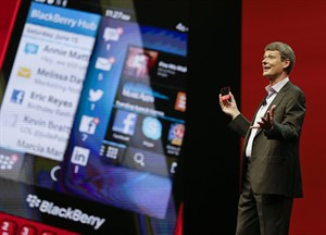 Thorsten Heins, president and CEO at BlackBerry holds up the new BlackBerry 10 mobile device at a conference, Tuesday, May 14, 2013, in Orlando, Fla. (AP Photo/John Raoux)