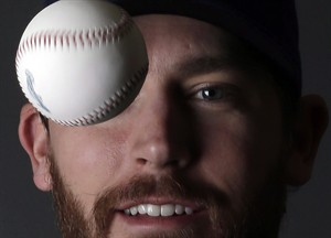 Milwaukee Brewers' John Axford poses during photo day before a spring training baseball workout on Sunday, Feb. 17, 2013, in Phoenix. Axford and teammate Jim Henderson were reunited last season, when the latter ended a 10-year minor- league odyssey by being recalled by the Brewers in July 2012. THE CANADIAN PRESS/AP/Morry Gash
