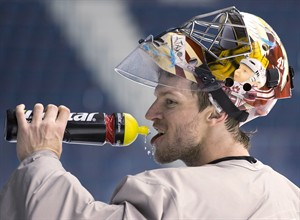 Team Canada goalkeeper Mike Smith pauses for water during a practice Wednesday, May 8, 2013 at the world hockey championship in Stockholm, Sweden. Smith has gone from a goaltender no NHL team wanted to a candidate for Canada's next Olympic team. THE CANADIAN PRESS/Jacques Boissinot