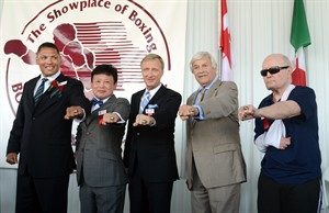 CORRECTS TO YUH MYUNG-WOO- The 2013 International Boxing Hall of Fame inductees, from left to right, Virgil Hill, Yuh Myung-woo, Jimmy Lennon, Jr., Colin Hart and Mills Lane pose with their induction rings after being inducted into the International Boxing Hall of Fame at the annual induction ceremony in Canastota, N.Y., Sunday, June 9, 2013. (AP photos/Heather Ainsworth)