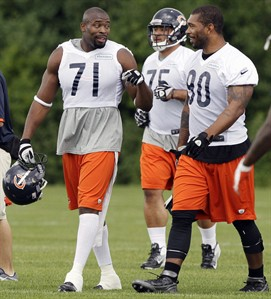 Chicago Bears defensive line Israel Idonije (71) talks with defensive end Julius Peppers (90) as they walk on the field during an NFL football practice in Lake Forest, Ill., Wednesday, May 30, 2012. Idonije has Sept. 29 and Nov. 10 circled on his calendar.Those are the days the Detroit Lions will face their arch rivals, the Chicago Bears, this season. After spending nine years in the Windy City, the Canadian defensive lineman will don the Lions' colours this season after signing a one-year deal in Motown as a free agent. THE CANADIAN PRESS/AP/Nam Y. Huh