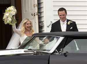 Toronto Maple Leafs captain Dion Phaneuf and actress Elisha Cuthbert head from their wedding at St. James Catholic Church in Summerfield, P.E.I. on Saturday, July 6, 2013. THE CANADIAN PRESS/Andrew Vaughan