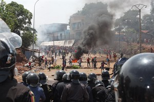 FILE- In this May 23, 2013 file photo, opposition protestors clash with police in Conakry, Guinea. Guinea's opposition announced on Wednesday, July 3, 2013, that they had succeeded in reaching an agreement with the country's ruling party, which will allow the West African nation to hold long-delayed legislative elections this fall. (AP Photo/Youssouf Bah, File)