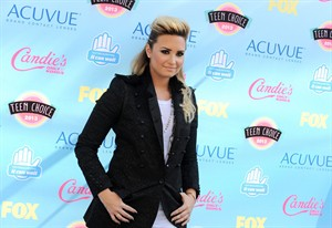 """FILE - In this Aug. 11, 2013 file photo, Demi Lovato arrives at the Teen Choice Awards at the Gibson Amphitheater, in Los Angeles. Lovato will appear on multiple episodes of the upcoming fifth season of """"Glee,"""" her publicist confirms. (Photo by Jordan Strauss/Invision/AP, File)"""