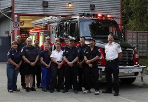 Malahat Fire Rescue Fire Chief Rob Patterson, far right, with his team of volunteer firefighters and their new Freightliner M2 business class truck at the fire hall in Malahat, B.C. Thursday August 22, 2013. THE CANADIAN PRESS/Chad Hipolito