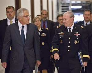 Defense Secretary Chuck Hagel, left, and Joint Chiefs Chairman Gen. Martin Dempsey, right, arrive for a closed-door intelligence briefing for members of the Senate Armed Services Committee, on Capitol Hill in Washington, Wednesday, Sept. 4, 2013, as President Barack Obama seeks congressional authorization for military intervention in Syria.