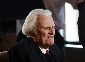 FILE - In this Dec. 20, 2010 file photo, evangelist Billy Graham, 92, speaks during an interview at the Billy Graham Evangelistic Association headquarters in Charlotte, N.C. Mark DeMoss of the Atlanta-based DeMoss Group said Wednesday, Nov. 20, 2013 that the 95-year-old evangelist had been admitted for observation at Mission Hospital in Asheville, N.C. DeMoss says he expected Graham would be able to go home in a day or so. (AP Photo/Nell Redmond, File)