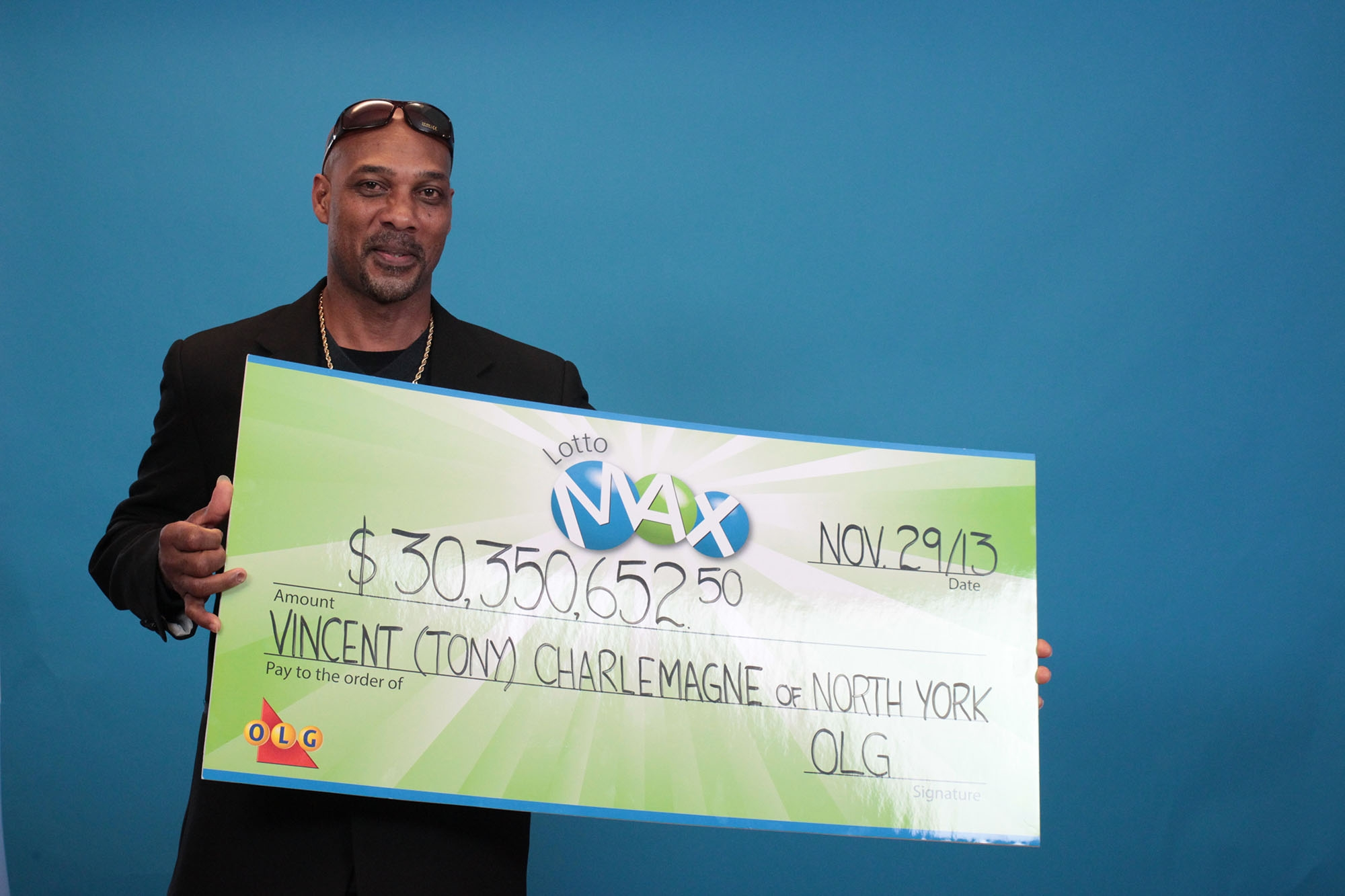 Vincent (Tony) Charlemagne of Toronto picked up his cheque for $30,350,652.50 from the August 2, 2013 LOTTO MAX draw at the OLG Prize Centre in Toronto on Friday, November 29, 2013