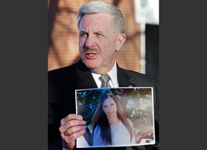 FILE - In this Saturday, Dec. 14, 2013, file photo, Arapahoe County Sheriff Grayson Robinson holds a picture of Claire Davis, the 17-year-old student who was shot in the head by a classmate, during a briefing at Arapahoe High School in Centennial, Colo. Hospital officials said in a statement Saturday, Dec. 21, 2013, that Davis has died. (AP Photo/Ed Andrieski, File)