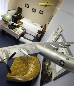In this photo made on Friday, Dec. 20, 2013, a pair of model airplanes hang from the ceiling of a room at the Jimmy Stewart Museum in Indiana, Pa. Local students came up with a scheme that reflected what a teenage Jimmy Stewart's bedroom would look have looked like. The museum dedicated to the life of the star of many films is located in the off-the-beaten track town where Stewart grew up. The museum still attracts visitors from all over the country. It's full of displays not just about Hollywood, but about Stewart's service as a bomber pilot in World War II, his well-to-do ancestors, and his family life. (AP Photo/Keith Srakocic)