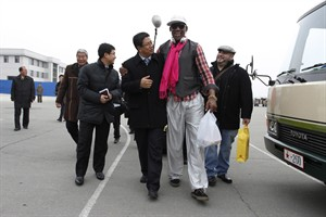 Former NBA basketball star Dennis Rodman, second right, walks with North Korea's Sports Ministry Vice Minister Son Kwang Ho, third right, upon his arrival at the international airport in Pyongyang, North Korea, Monday, Jan. 6, 2014. Rodman took a team of former NBA players on a trip for an exhibition game on Kim Jong Un's birthday, Wednesday, Jan. 8. (AP Photo/Kim Kwang Hyon, File)