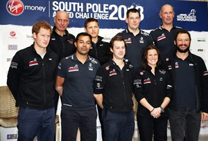 Britain's Prince Harry, left, the Expedition Patron, poses with members of the Walking With The Wounded South Pole Allied Challenge 2013 team, following a welcome home news conference, in central London, Tuesday, Jan. 21, 2014. The Walking With The Wounded Virgin Money South Pole Allied Challenge 2013 concluded on Friday 13 December, when three teams of wounded servicemen and women successfully reached the South Pole after crossing 200km of Antarctic plateau. (AP Photo/Lefteris Pitarakis, Pool)