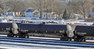 The National Transportation Safety Board onThursday Jan. 23, 2014 asked for stricter safety measures for transporting crude oil by rail. One proposal by the NTSB would call for railroads to have careful route plannng for trains with hazardous materials and to avoid populated areas. Above, a line of tanker cars used to carry crude oil in the Mandan railyard on Thursday afternoon. (AP Photo/The Bismarck Tribune, Tom Stromme)