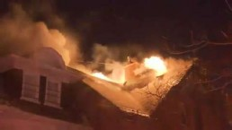 Crews battle house fire in downtown Toronto