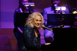 FILE - In this May 21, 2013 file photo, singer-songwriter Carole King, performs during an event to honor her with the Gershwin Prize for Popular Song, at the Library of Congress, in Washington.King is the 2014 MusiCares person of the year being honored on Friday, Jan. 24, 2014, in Los Angeles. The Dixie Chicks, Lady Gaga, Bette Midler and James Taylor are scheduled to perform. (AP Photo/Alex Brandon, File)