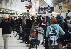 Passengers line-up at Pearson International Airport in Toronto on January 7, 2014. THE CANADIAN PRESS/Aaron Vincent Elkaim