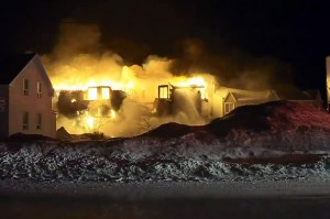 A fire burns at a seniors' home in L'Isle-Verte, about 240 kilometres northeast of Quebec City, on Jan. 23, 2014. BREAKFAST TELEVISION MONTREAL