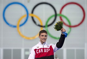 Canada's Denny Morrison stands on the podium Saturday February 15, 2014 in Sochi, Russia. THE CANADIAN PRESS/Adrian Wyld