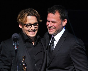 Actor Johnny Depp (L) and make-up artist and presenter Joel Harlow are seen after Depp accepted the Distinguished Artisan Award at Make-Up Artists and Hair Stylists Guild Awards on Saturday, Feb. 15, 2014 at Paramount Studios in Los Angeles, California (Photo by Vince Bucci/Invision/AP)