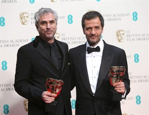 Alfonso Cuaron and David Heyman, winners of outstanding British film for Gravity, pose for photographers in the winners room at the EE British Academy Film Awards held at the Royal Opera House on Sunday Feb. 16, 2014, in London. (Photo by Joel Ryan/Invision/AP)