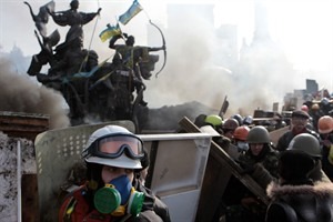 Anti-government protesters protect themselves with shields during clashes with riot police in Kyiv's Independence Square, the epicenter of the country's current unrest in Kyiv, Ukraine, on Feb. 19, 2014. The ASSOCIATED PRESS/Sergei Chuzavkov