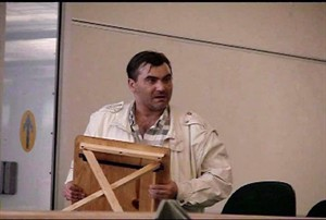Robert Dziekanski holds a small table at the Vancouver Airport before he was tasered by police in this image from video. New indictments have been filed against two Mounties accused of perjury at a public inquiry into Dziekanski's death, adding an allegation the officers lied when they testified that they hadn't talked about what happened after his death.THE CANADIAN PRESS/HO-Paul Pritchard