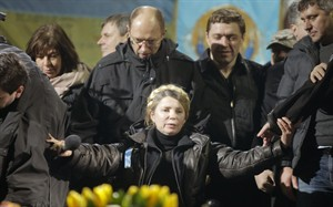 Former Ukrainian prime minister Yulia Tymoshenko addresses the crowd in central Kiev, Ukraine, Saturday, Feb. 22, 2014. Hours after being released from prison, former Ukrainian prime minister and opposition icon Yulia Tymoshenko praised the demonstrators killed in violence this week as heroes.(AP Photo/Efrem Lukatsky)
