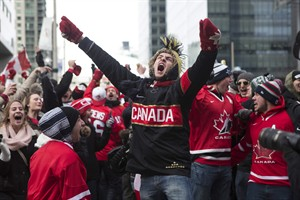Hockey fans celebrate as Chris Kunitz scores Canada's third goal in the Olympic Hockey final in Toronto's Maple Leaf Square on Sunday, February 23, 2014. Canada beat Sweden 3-0 to win the Gold Medal. THE CANADIAN PRESS/Chris Young