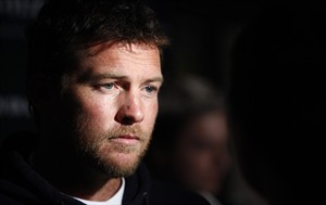"""FILE - In this Jan. 19, 2012 file photo, Actor Sam Worthington attends the Cinema Society premiere of """"Man on a Ledge"""" in New York. Police say Worthington has been arrested Sunday, Feb. 23, 2014, in New York City for punching a photographer after the man kicked Worthington's girlfriend in the shin. The Australian actor was released on a desk appearance ticket and is due back in court on Feb. 26. (AP Photo/Peter Kramer, File)"""