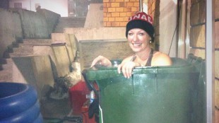 Gold medal winner Heather Moyse soaking in a garbage can in Sochi. TWITTER/@HeatherMoyse