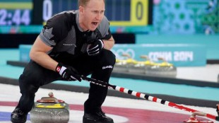 Brad Jacobs leads his team to a gold medal win in men's curling at the Sochi Winter Games on Feb. 21, 2014. CANADIAN OLYMPIC COMMITTEE