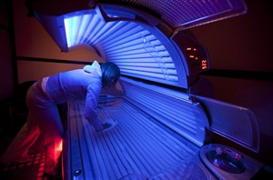 An attendant cleans a tanning bed in North Vancouver, March, 20, 2012. THE CANADIAN PRESS/Jonathan Hayward