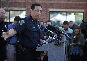 Austin Police Chief address the media during a news conference on Thursday, March 13, 2014 in Austin, Texas. A suspected drunken driver barreled through police barricades and drove down a crowded street at the South by Southwest festival early Thursday morning, killing two people and injuring 23 in an act authorities say was intentional. The driver struck multiple pedestrians at about 12:30 a.m. on a block filled with concertgoers, continued down the street and hit and killed a man from the Netherlands on a bicycle and a woman from Austin on a moped, Acevedo said. (AP Photo/The Daily Texan, Shweta Gulati)