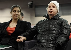 Briana Nash, left, looks at her mother, Charla Nash after she finished speaking to Connecticut legislators at a public hearing at the Legislative Office Building, Friday, March 21, 2014, in Hartford, Conn. Nash who was mauled by a friend's chimpanzee in 2009 is making a personal plea to allow her to sue the state for $150 million in damages. The panel is considering a bill that would override the June decision by the State Claims Commissioner, who dismissed Nash's initial request for permission to sue. The state generally is immune from lawsuits, unless allowed by the claims commissioner. (AP Photo/Jessica Hill)