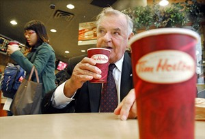 Ron Joyce sips a coffee in Toronto on Friday, October 20, 2006. Joyce, the co-founder of the Tim Hortons empire, isn't likely to take a meeting with just anyone.But spend 20 hours doing volunteer work for a good cause and he'll sit down for a talk over a couple of double-doubles, no problem. THE CANADIAN PRESS/Aaron Harris