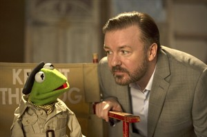 """This image released by Disney shows the muppet character Kermit the frog, left, and Ricky Gervais in a scene from """"Muppets Most Wanted."""" (AP Photo/Disney Enterprises, Inc., Jay Maidment, file)"""