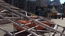 No injuries after scaffolding falls on taxi in downtown Toronto