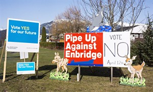 Competing campaign signs are seen in Kitimat, B.C. on Saturday, April 12, 2014, as voters cast their ballots in the town's plebiscite on the Northern Gateway pipeline project. A good turnout is expected as Kitimat residents express their opinion on the controversial project. THE CANADIAN PRESS/Robin Rowland