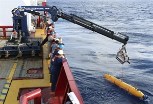In this Monday, April 14, 2014, photo provided by the Australian Defense Force an autonomous underwater vehicle is deployed from ADV Ocean Shield in the search of the missing Malaysia Airlines Flight 370 in the southern Indian Ocean. The search area for the missing Malaysian jet has proved too deep for the robotic submarine which was hauled back to the surface of the Indian Ocean less than half way through its first seabed hunt for wreckage and the all-important black boxes, authorities said on Tuesday. (AP Photo/Australian Defense Force, Lt. Kelli Lunt) EDITORIAL USE ONLY