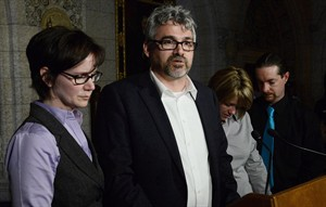 Leah Parsons, second from right, mother of Rehtaeh Parsons and her partner Jason Barnes as well as Rehtaeh's father Glen Canning, second from left, and wife his Krista speak to reporters on Parliament Hill in Ottawa on April 23, 2013. Police in Halifax have charged a young man accused of making death threats against the father of Rehtaeh Parsons. THE CANADIAN PRESS/ Sean Kilpatrick
