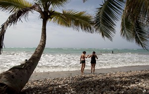 In this June 28, 2013 photo, tourists walk on the shore of the Raymond les bains beach in Jacmel, Haiti. Although its sandy white beaches may rival any country in the Caribbean, Haiti's troubled past has set the country far behind its neighbours when it comes to tourism. THE CANADIAN PRESS/AP, Dieu Nalio Chery