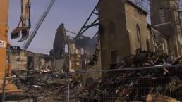Aurora church fire smoulders into Saturday
