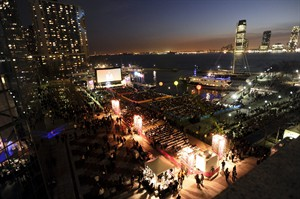 """FILE - This April 20, 2011 file photo shows an outdoor screening during the Tribeca Film Festival in New York. When the 13th annual New York festival debuts Wednesday night, it will present not just 80-plus feature films, but an """"Innovation Week"""" that seems designed to capture some of the tech energy of SXSW. (AP Photo/Evan Agostini, File)"""